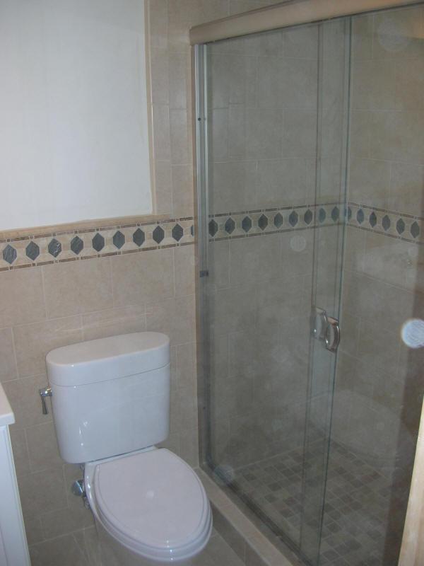 Bathroom tiles half wall awesome brown bathroom tiles for Half tiled bathroom ideas